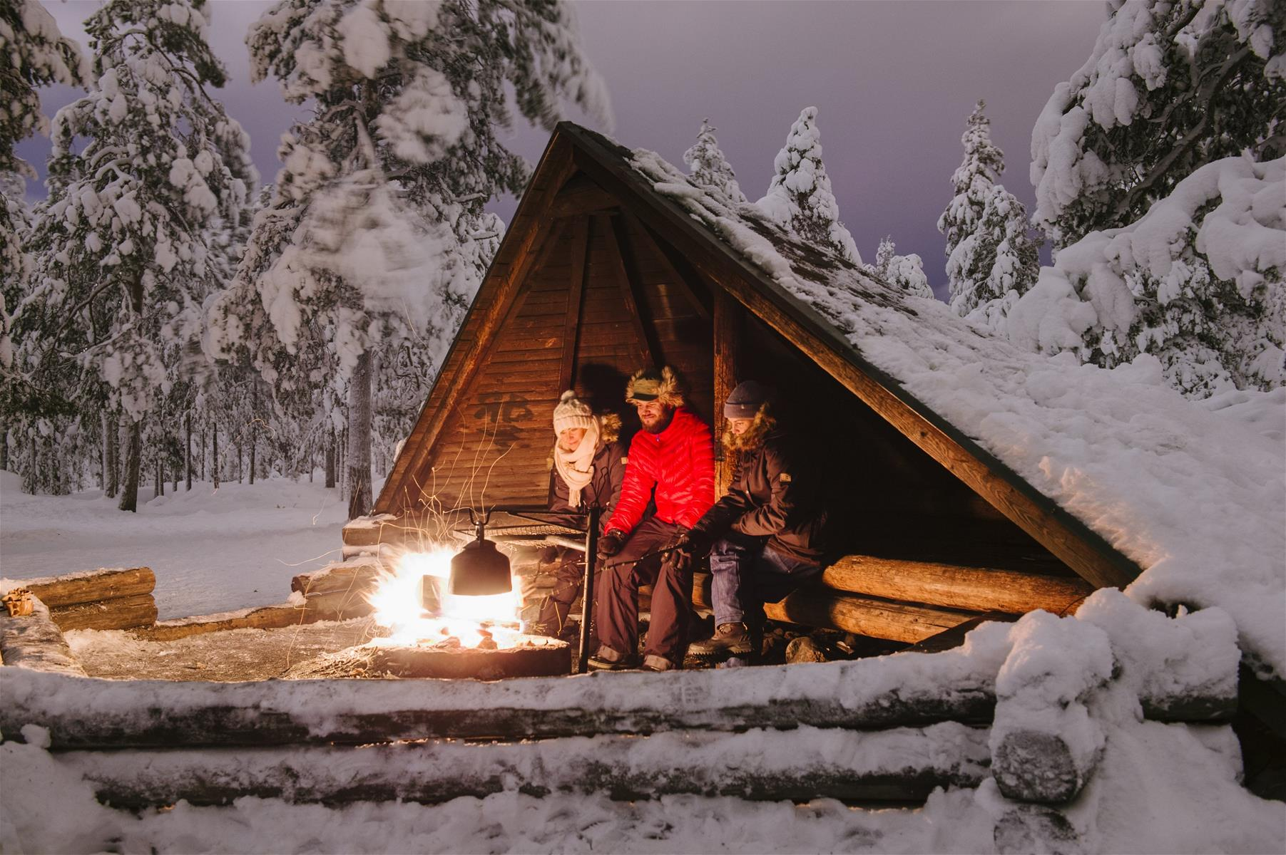 Frying Sausages by open fire in winter in Rovaniemi Lapland Finland (2).jpg